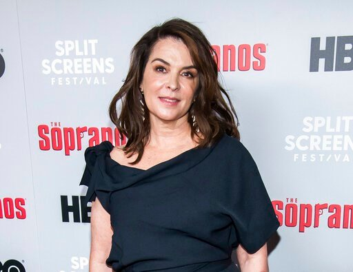 """(Photo by Charles Sykes/Invision/AP, File). FILE - In this Jan. 9, 2019, file photo, Annabella Sciorra attends HBO's """"The Sopranos"""" 20th anniversary at the SVA Theatre in New York. Sciorra is set to confront Harvey Weinstein at his New York City rape t..."""