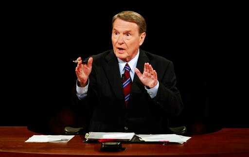 (AP Photo/Chip Somodevilla, File). FILE - This Sept. 26, 2008 file photo shows debate moderator Jim Lehrer during the first U.S. Presidential Debate between presidential nominees Sen. John McCain, R-Ariz., and Sen. Barack Obama, D-Ill., at the Universi...