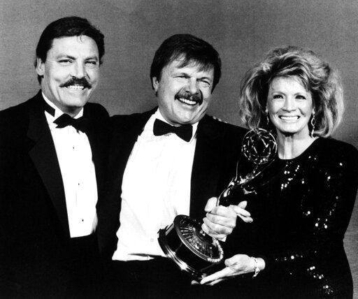 """(AP Photo/Douglas C. Pizac, File). FILE - This Sept. 21, 1986 file photo shows actor John Karlen, center, who portrays the husband of detective Mary Beth Lacey on the TV show """"Cagney & Lacey, """" posing with presenters Stacy Keach, left, and Angie Di..."""
