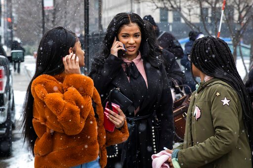 (Ashlee Rezin Garcia/Chicago Sun-Times via AP). Flanked by supporters, Joycelyn Savage, center, one of R&B singer R. Kelly's girlfriends, walks out of the Cook County Domestic Violence Courthouse, Thursday morning, Jan. 23, 2020, in Chicago. Savage...