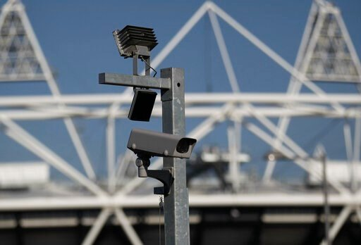 (AP Photo/Sang Tan, FILE). FILE - In this file photo dated Wednesday, March 28, 2012, a security cctv camera is seen by the Olympic Stadium at the Olympic Park in London.  The South Wales police deployed facial recognition surveillance equipment on Sun...