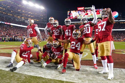 (AP Photo/Tony Avelar). San Francisco 49ers players celebrate after cornerback Richard Sherman, bottom center, intercepted a pass against the Green Bay Packers during the second half of the NFL NFC Championship football game Sunday, Jan. 19, 2020, in S...