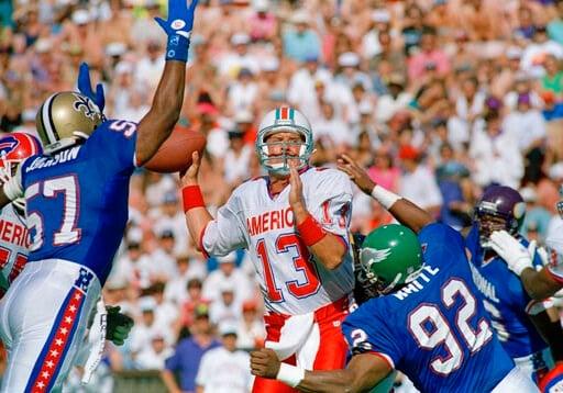 (AP Photo/Paul Sakuma, File). File-This Feb. 7, 1993, file photo shows Miami Dolphins quarterback Dan Marino (13) of the AFC squad, under pressure  from New Orleans linebacker Rickey Jackson (57) and Philadelphia Eagles defensive end Reggie White (92) ...