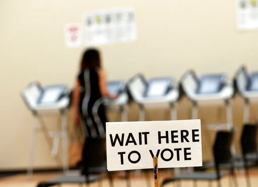 (AP Photo/John Bazemore, File). FILE - In this May 9, 2018, file photo, a woman votes in Sandy Springs, Ga. It's been more than three years since Russia's sweeping effort to interfere in U.S. elections through disinformation on social media, stolen cam...