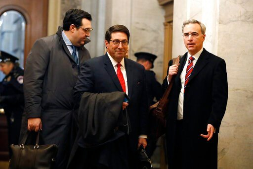 (AP Photo/Julio Cortez). President Donald Trump's personal attorney Jay Sekulow, center, stands with his son, Jordan Sekulow, left, and White House Counsel Pat Cipollone, while arriving at the Capitol in Washington during the impeachment trial of Presi...