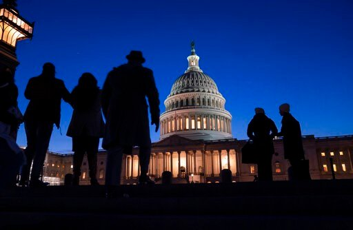 (AP Photo/J. Scott Applewhite, File). FILE - In this Jan. 22, 2020 file photo, night falls on the Capitol, in Washington during the impeachment trial of President Donald Trump. For all the gravity of a presidential impeachment trial, Americans don't se...
