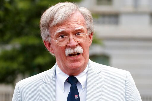 (AP Photo/Carolyn Kaster). FILE - In this July 31, 2019 file photo, then National security adviser John Bolton speaks to media at the White House in Washington.  Bolton says he's 'prepared to testify' in Senate impeachment trial if subpoenaed