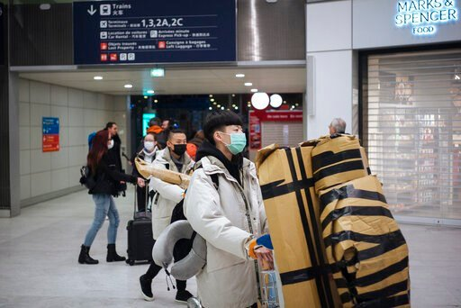 (AP Photo/Kamil Zihnioglu). Travelers from Beijing , wearing masks, arrive at Charles de Gaulle airport, north of Paris, early Monday, Jan. 27, 2020. France's government announced Sunday it will repatriate up to hundreds of French citizens from the Chi...