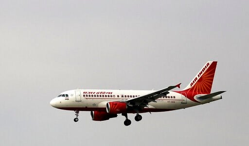 (AP Photo/Altaf Qadri, File). FILE - In this April 16, 2015 file photo, an Air India aircraft prepares to land at the Indira Gandhi International airport in New Delhi, India. India said Monday it plans to sell its entire stake in the national carrier A...