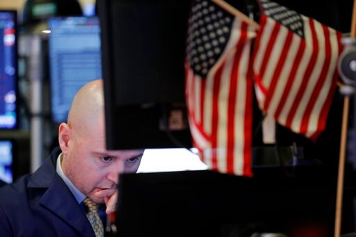 (AP Photo/Seth Wenig, File). FILE - In this Jan. 8, 2020, file photo a trader works on the floor at the New York Stock Exchange in New York. The U.S. stock market opens at 9:30 a.m. EST on Monday, Jan. 27.