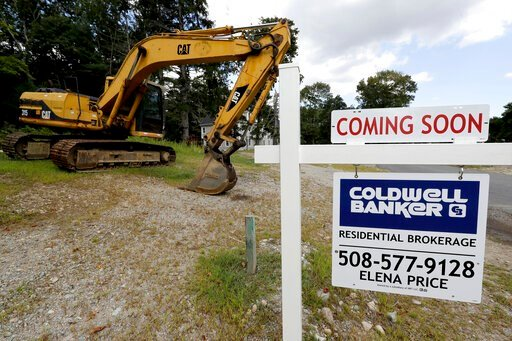 (AP Photo/Steven Senne, File). FILE - In this Sept. 3, 2019, file photo a sign rests near a piece of earth-moving equipment, left, on a plot of land, in Westwood, Mass. On Monday, Jan. 27, 2020, the Commerce Department reports on sales of new homes in ...