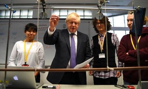 (Daniel Leal-Olivas/Pool via AP). Britain's Prime Minister Boris Johnson, center left, visits the Department of Mathematics at King's Maths School, part of King's College London University, in London, Monday Jan. 27, 2020.
