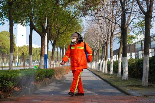 (AP Photo/Arek Rataj). A worker wearing a face mask sprays disinfectant along a path in Wuhan in central China's Hubei Province, Tuesday, Jan. 28, 2020. China's death toll from a new viral disease that is causing global concern rose by 25 to at least 1...