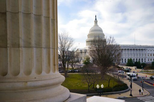 (AP Photo/J. Scott Applewhite). The Capitol is seen as defense arguments by the Republicans resume in the impeachment trial of President Donald Trump on charges of abuse of power and obstruction of Congress, in Washington, Monday, Jan. 27, 2020.