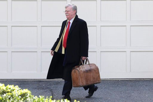 (AP Photo/Luis M. Alvarez). Former National security adviser John Bolton leaves his home in Bethesda, Md. Tuesday, Jan. 28, 2020. President Donald Trump's legal team is raising a broad-based attack on the impeachment case against him even as it mostly ...