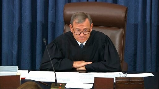(Senate Television via AP). In this image from video, presiding officer Chief Justice of the United States John Roberts speaks during the impeachment trial against President Donald Trump in the Senate at the U.S. Capitol in Washington, Tuesday, Jan. 28...