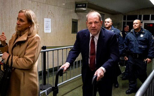 (AP Photo/Craig Ruttle). Harvey Weinstein leaves for the day during his trial on charges of rape and sexual assault, Tuesday, Jan. 28, 2020 in New York.