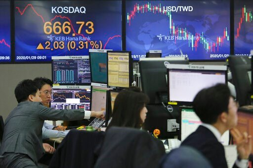 (AP Photo/Ahn Young-joon). Currency traders watch monitors at the foreign exchange dealing room of the KEB Hana Bank headquarters in Seoul, South Korea, Wednesday, Jan. 29, 2020. Shares are mostly higher in Asia after a rebound on Wall Street that reve...