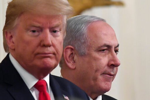 (AP Photo/Susan Walsh). President Donald Trump, left, and Israeli Prime Minister Benjamin Netanyahu, right, during an event in the East Room of the White House in Washington, Tuesday, Jan. 28, 2020, to announce the Trump administration's much-anticipat...