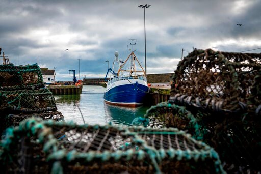 (AP Photo/David Keyton). In this Tuesday, Jan. 28, 2020 photo, a fishing vessel is docked at Kilkeel harbor in Northern Ireland. The United Kingdom and the European Union are parting ways on Friday and one of the first issues to address is what will ha...