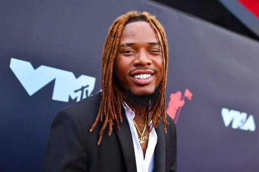 (Photo by Charles Sykes/Invision/AP, File). FILE - In this Aug. 26, 2019, file photo, Fetty Wap arrives at the MTV Video Music Awards at the Prudential Center on in Newark, N.J. A judge has agreed to a conditional dismissal of misdemeanor battery charg...