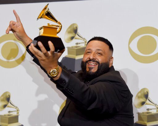 "(AP Photo/Chris Pizzello). DJ Khaled poses in the press room with the award for best rap/sung performance for ""Higher"" at the 62nd annual Grammy Awards at the Staples Center on Sunday, Jan. 26, 2020, in Los Angeles."