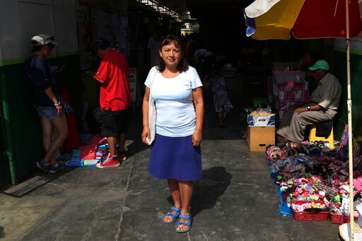 (AP Photo/Martin Mejia). In this Feb. 6, 2020, photo, Peruvian Margarita Del Pilar Fitzpatrick, poses for a portrait at San Martin de Porres neighborhood in Lima, Peru. The day Fitzpatrick applied for an Illinois driver's license upended her life. When...