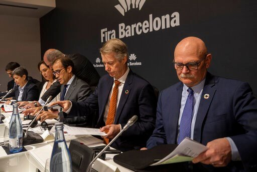 (AP Photo/Emilio Morenatti). Director general of the GSMA Mats Granryd, center, and CEO and Director for GSMA Ltd. John Hoffman, right, take part in a press conference in Barcelona, Spain, Thursday, Feb. 13, 2020, after it was announced the annual Mobi...