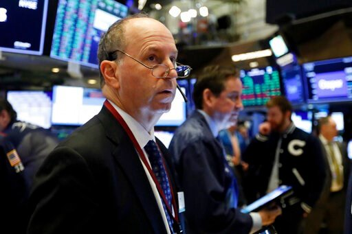 (AP Photo/Richard Drew, File). FILE - In this Feb. 6, 2020, file photo trader Gordon Charlop works on the floor of the New York Stock Exchange. The U.S. stock market opens at 9:30 a.m. EST on Thursday, Feb. 13.