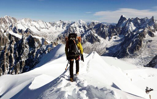 (AP Photo/David Azia,File). FILE - In this file photo taken on Oct. 12, 2011, an alpinist heads down a ridge on the Aiguille du Midi (3,842 meters; 12 605 feet), towards the Vallee Blanche on the Mont Blanc massif, in the Alps, near Chamonix. French Pr...