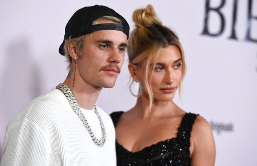 """(Photo by Jordan Strauss/Invision/AP). Justin Bieber and Hailey Baldwin arrive at the Los Angeles premiere of """"Justin Bieber: Seasons,"""" Monday, Jan. 27, 2020."""
