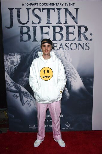 """(Photo by Jordan Strauss/Invision/AP). Justin Bieber arrives at the Los Angeles premiere of """"Justin Bieber: Seasons,"""" Monday, Jan. 27, 2020."""