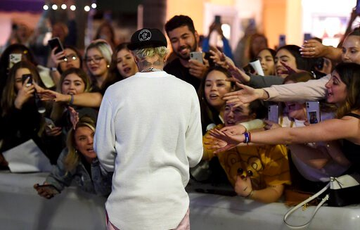 """(Photo by Jordan Strauss/Invision/AP). arrives at the Los Angeles premiere of """"Justin Bieber: Seasons,"""" Monday, Jan. 27, 2020."""