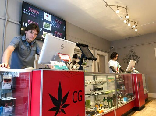 (AP Photo/Morgan Lee,File). FILE - In this March 6, 2019 file photo, Korbin Osborn, left, works as a cannabis adviser at a medical marijuana dispensary in Santa Fe, N.M. New Mexico would legalize recreational marijuana sales without exceptions for diss...