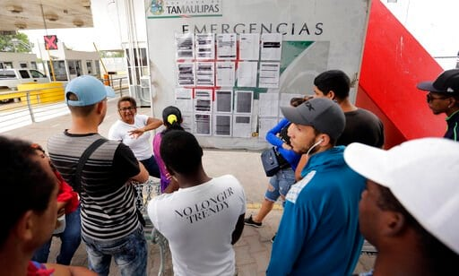 (AP Photo/Eric Gay, File). FILE - In this April 30, 2019, file photo, Cynthia Mayrena, 29, of Nicaragua, describes how the list of asylum seekers works in Matamoros, Mexico. Newly unsealed court documents show that many U.S. holding cells along the Mex...