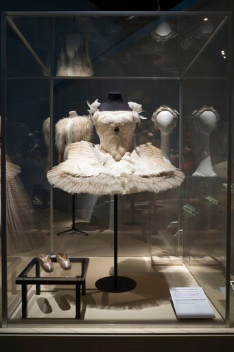 """(Eileen Costa/The Museum at FIT via AP). This photo provided by The Museum at FIT shows the """"Dying Swan"""" tutu, head piece, and pointe shoes worn by iconic Russian ballerina Anna Pavlova, that are part of the new exhibit at the Fashion Institute of Tech..."""