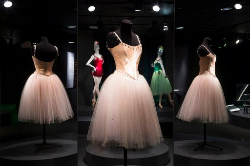"""(Eileen Costa/The Museum at FIT via AP). This photo provided by The Museum at FIT shows, foreground, """"Dewdrop"""" costume from The Nutcracker and background, left to right: """"Rubies"""" and """"Emeralds"""" costumes from Jewels, that are part of the new exhibit at ..."""