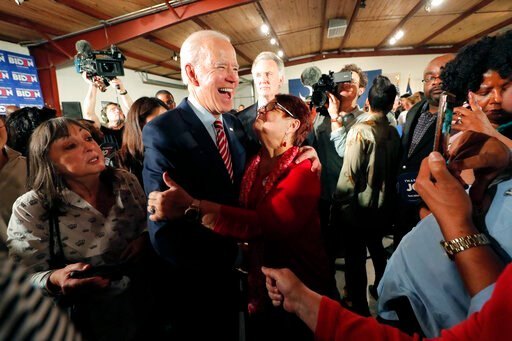 (AP Photo/Gerald Herbert). Democratic presidential candidate, former Vice President Joe Biden, greets supporters at a campaign event in Columbia, S.C., Tuesday, Feb. 11, 2020.