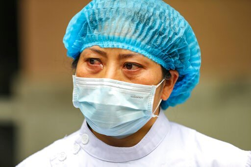 (Chinatopix Via AP). A nurse tears up as she talks about the situation in Jinyintan Hospital, designated for critical COVID-19 patients, in Wuhan in central China's Hubei province Thursday, Feb. 13, 2020. China on Thursday reported 254 new deaths and a...