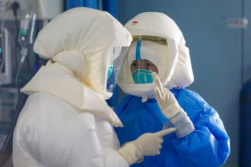 (Chinatopix Via AP). Medical staff work in the negative-pressure isolation ward in Jinyintan Hospital, designated for critical COVID-19 patients, in Wuhan in central China's Hubei province Thursday, Feb. 13, 2020. China on Thursday reported 254 new dea...