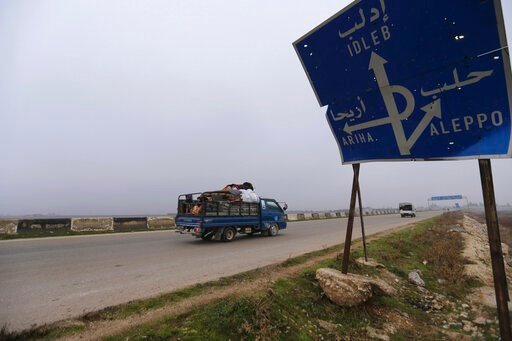 (AP Photo/Ghaith Alsayed, File). FILE - This Monday, Dec. 23, 2019, file photo, civilians ride in a truck as they flee Maaret al-Numan, Syria, ahead of a government offensive. The M5 highway, recaptured by President Bashar Assad's forces this week, is ...