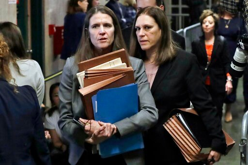 (AP Photo/Richard Drew). Assistant District Attorneys Meghan Hast, left, and Joan Illuzzi leave the Harvey Weinstein rape trial during the lunch break, Thursday, Jan. 23, 2020, in New York.