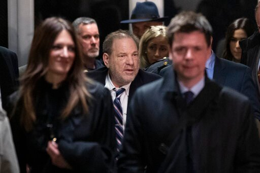 (AP Photo/Mary Altaffer). Harvey Weinstein, center, is surrounded by his attorneys Donna Rotunno, left, and Damon Cheronis, as he leaves court for the day in his rape trial, Thursday, Feb. 13, 2020, in New York.