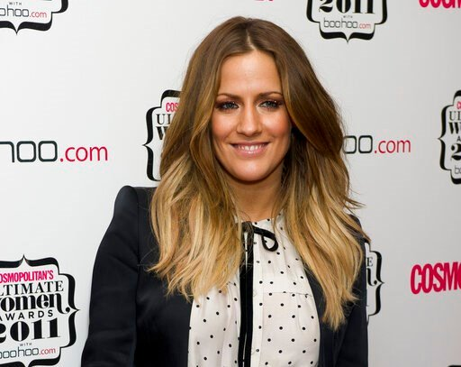 """(AP Photo/Jonathan Short, FILE). FILE - In this file photo dated Thursday, Nov. 3, 2011, British TV personality Caroline Flack arrives for the Cosmopolitan Ultimate Women of the Year Awards in London.  The host controversial reality TV show """"Love Islan..."""