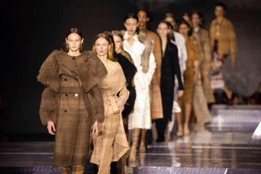 (Photo by Vianney Le Caer/Invision/AP). Models wear creations by designer Burberry at the Autumn/Winter 2020 fashion week runway show in London, Monday, Feb. 17, 2020.
