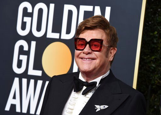 (Photo by Jordan Strauss/Invision/AP, File). FILE - In this Jan. 5, 2020 file photo, Elton John arrives at the 77th annual Golden Globe Awards at the Beverly Hilton Hotel, in Beverly Hills, Calif. An emotional John had to cut short a performance in New...