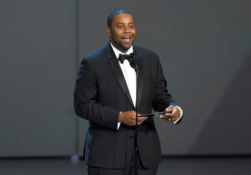 """(Photo by Chris Pizzello/Invision/AP, File). FILE - In this Sept. 17, 2018, file photo Kenan Thompson presents the award for outstanding drama series at the 70th Primetime Emmy Awards at the Microsoft Theater in Los Angeles. Thompson of """"Saturday Night..."""