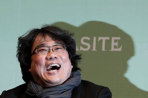 "(AP Photo/Ahn Young-joon). Bong Joon-ho, director of Oscar-winning ""Parasite,"" laughs during a press conference in Seoul, South Korea, Wednesday, Feb. 19, 2020. Bong said Wednesday ""the biggest pleasure and the most significant meaning"" that the film h..."