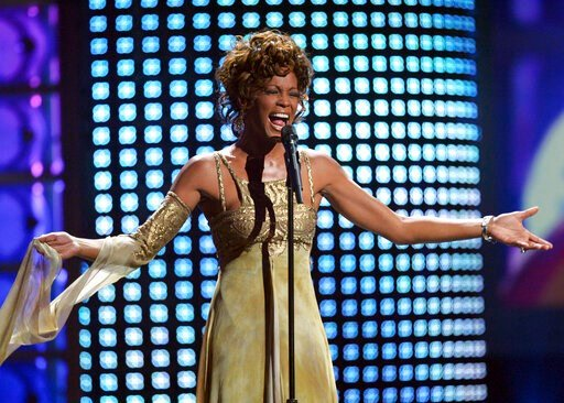 (AP Photo/Eric Jamison, file). FILE - In this Sept. 15, 2004 file photo, recording artist Whitney Houston performs at the 2004 World Music Awards at the Thomas and Mack Arena in Las Vegas. Houston is about to appear on the concert stage again. Eight ye...