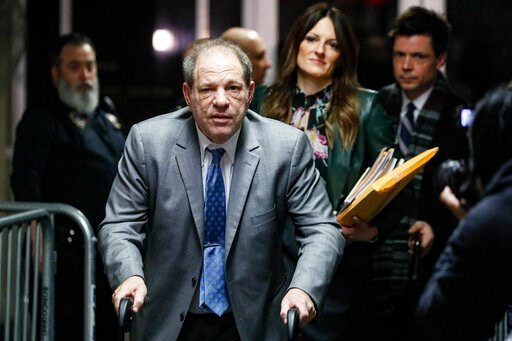 (AP Photo/John Minchillo). Harvey Weinstein leaves a Manhattan courthouse during his rape trial, Tuesday, Feb. 18, 2020, in New York.